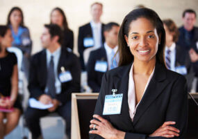 Pay monthly call answering service Businesswoman stood arms folded smiling conference
